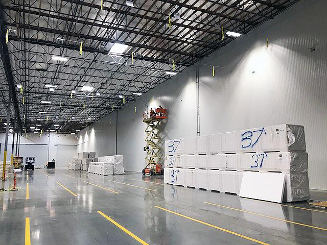warehouse with scissor lift